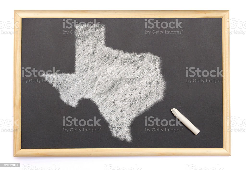 Blackboard with the shape of Texas drawn onto. stock photo