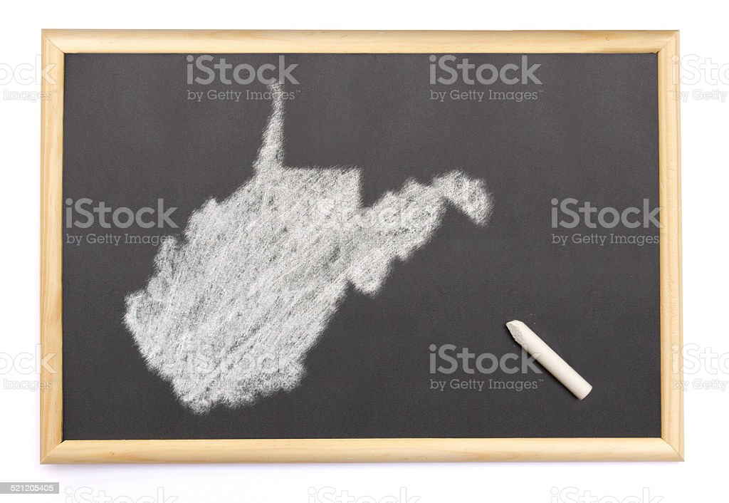 Blackboard with the shape of West Virginia drawn onto. stock photo