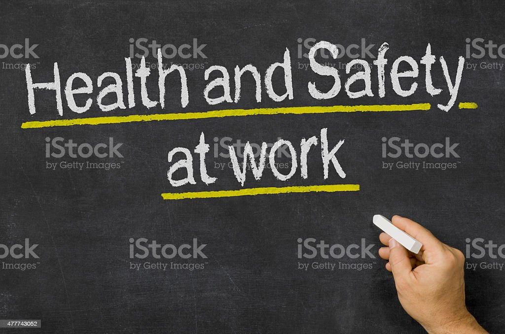 Blackboard with the text Health and Safety at work stock photo
