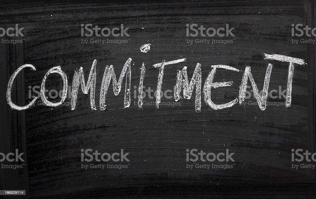 Blackboard with the word commitment written in white chalk stock photo