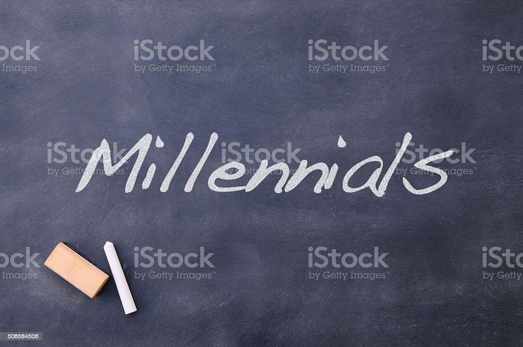 Blackboard with the word Millennials. stock photo