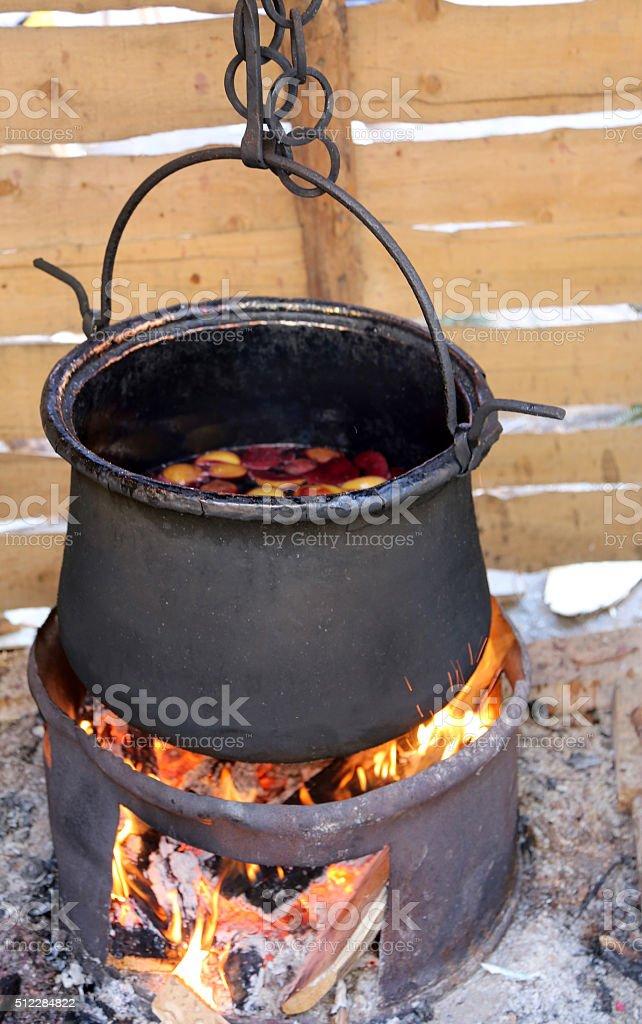 blackened cauldron to cook the tasty mulled wine stock photo