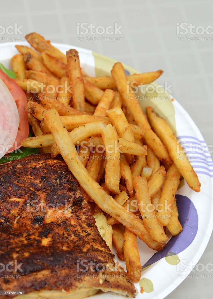 blackened fish sandwich with fries royalty-free stock photo