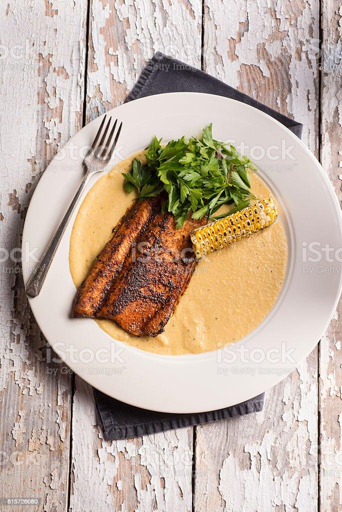 Blackened Trout Polenta stock photo