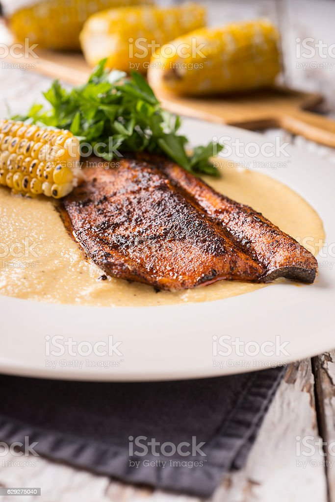 Blackened Trout Polenta stock photo