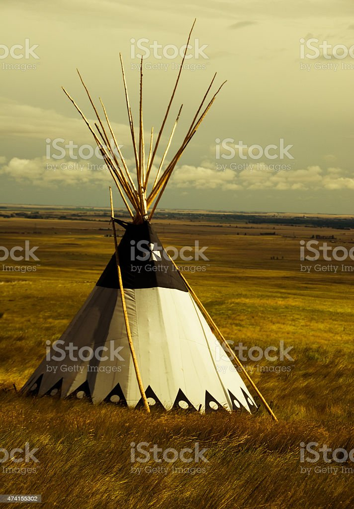 Blackfoot teepee on the prairie in the fall at sunset stock photo