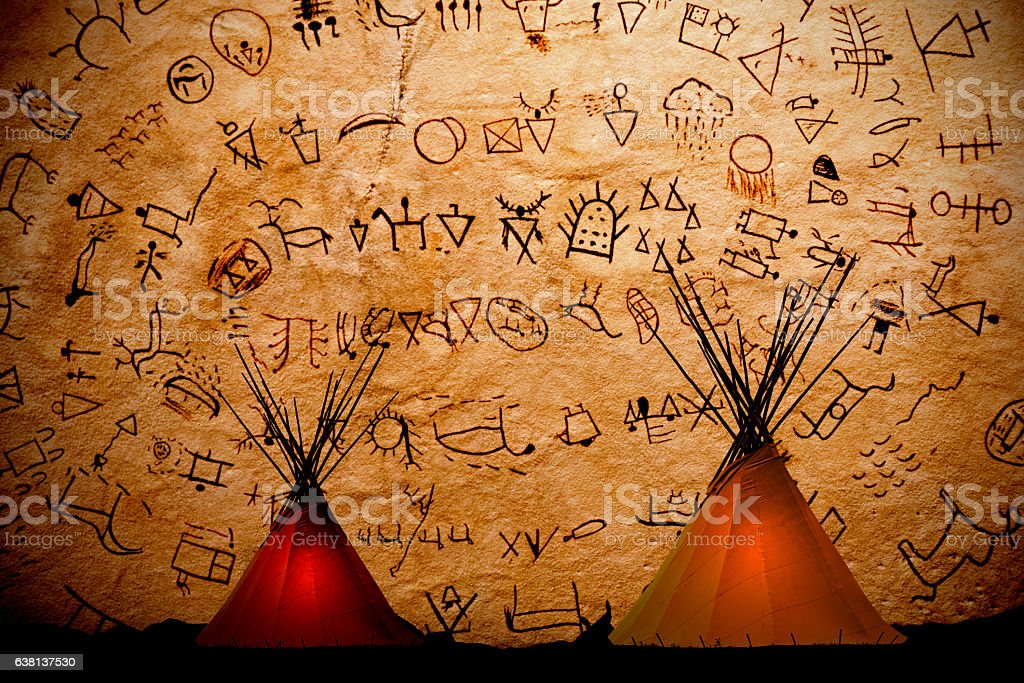 Blackfoot teepees with tribe symbols,writing,on background stock photo