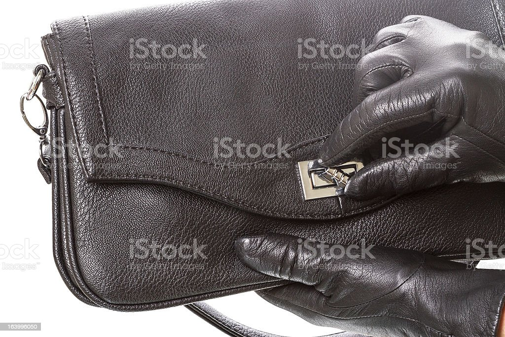 Black-gloved hand opens the handbag royalty-free stock photo