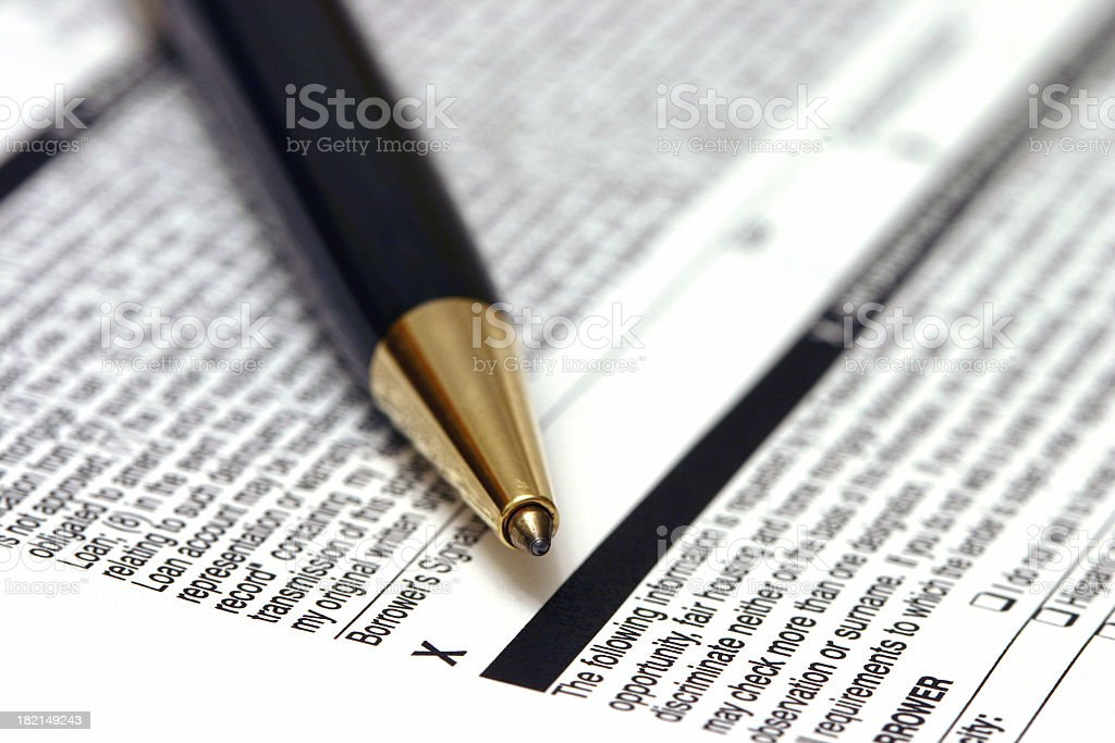 A black-gold pen on a mortgage application form royalty-free stock photo