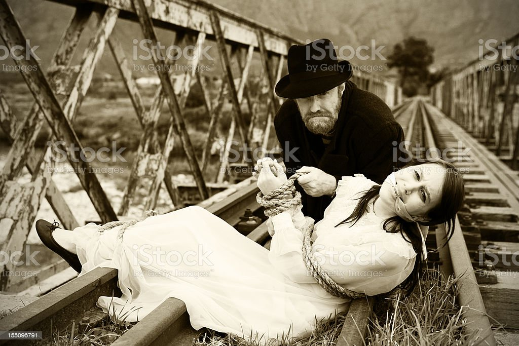 Black-hearted villain, kidnapped maiden, Victorian melodrama at its best stock photo