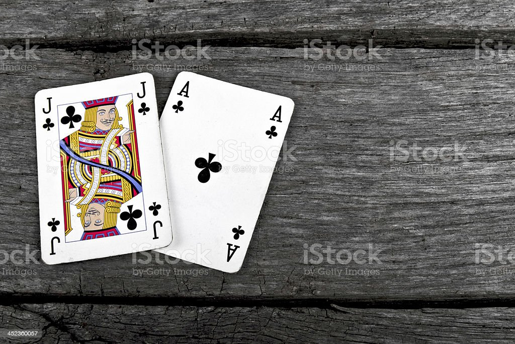 blackjack cards on old vintage wooden board ace and jack royalty-free stock photo