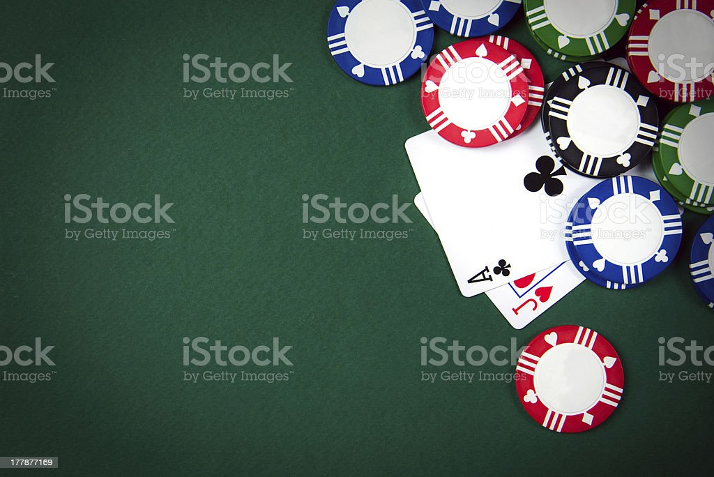 Blackjack cards with betting chips on green gambling table stock photo