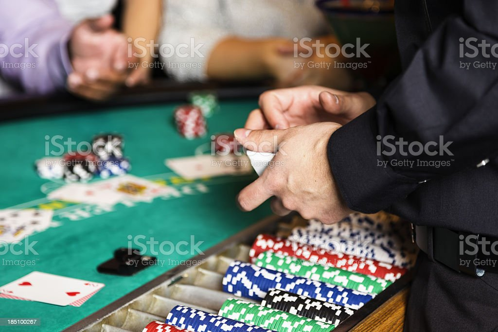 Blackjack Dealer Hands In a Casino stock photo