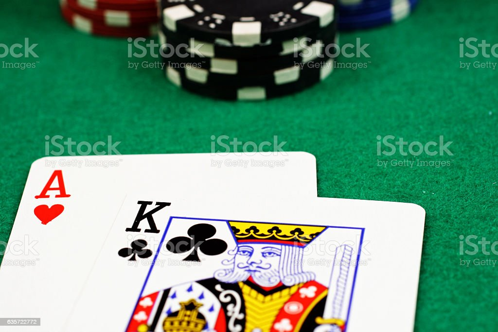 Blackjack hand on a felt table with chips stock photo