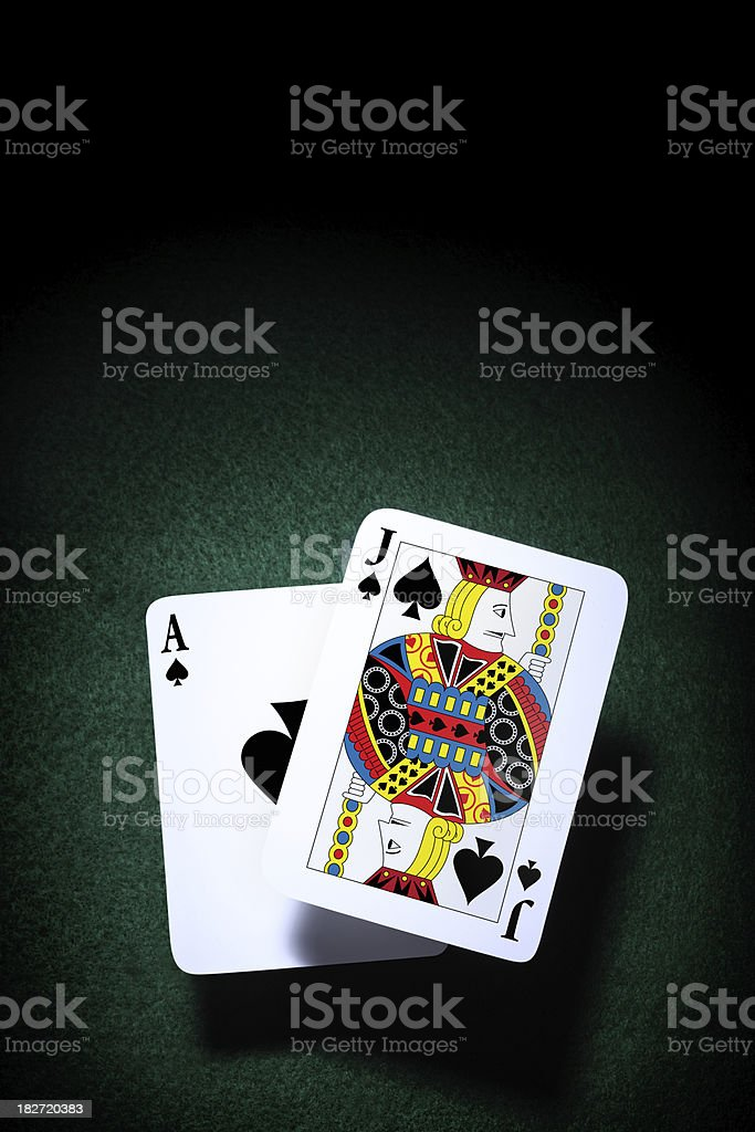 BlackJack Playing Cards on a Green Felt stock photo