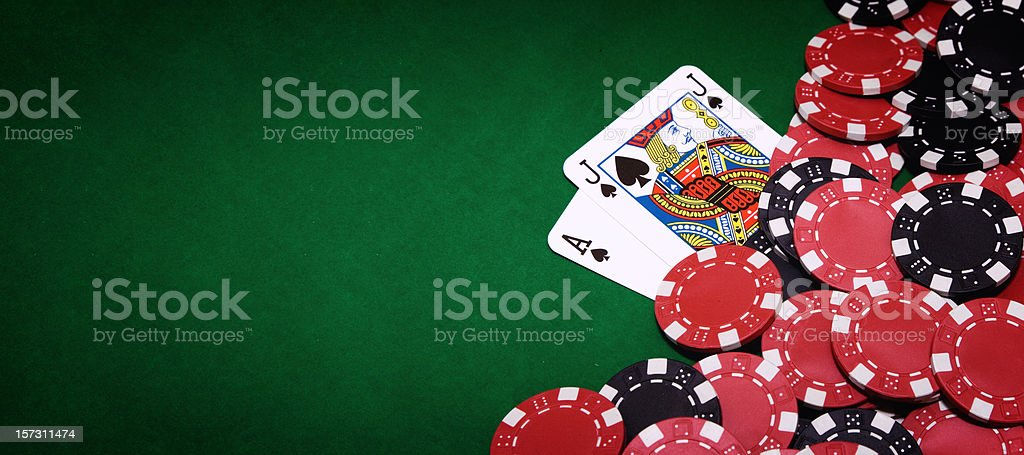 Blackjack table and pile of chips on right side of image stock photo