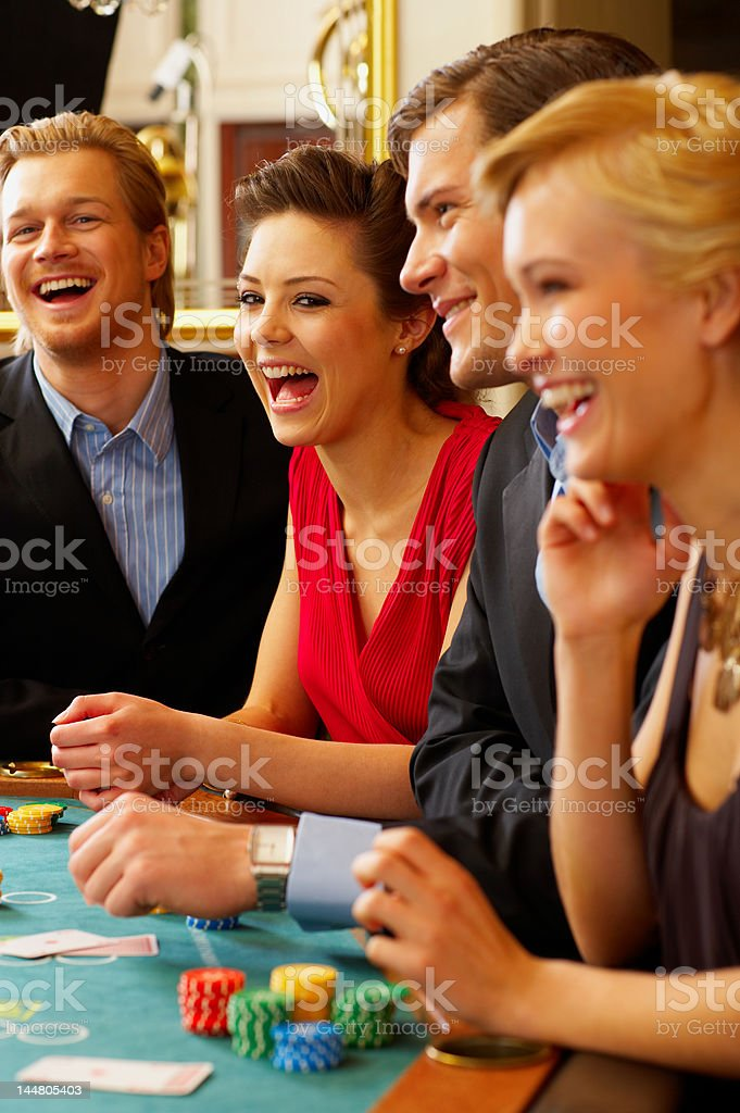 BlackJack Table. Friends having a good time! royalty-free stock photo