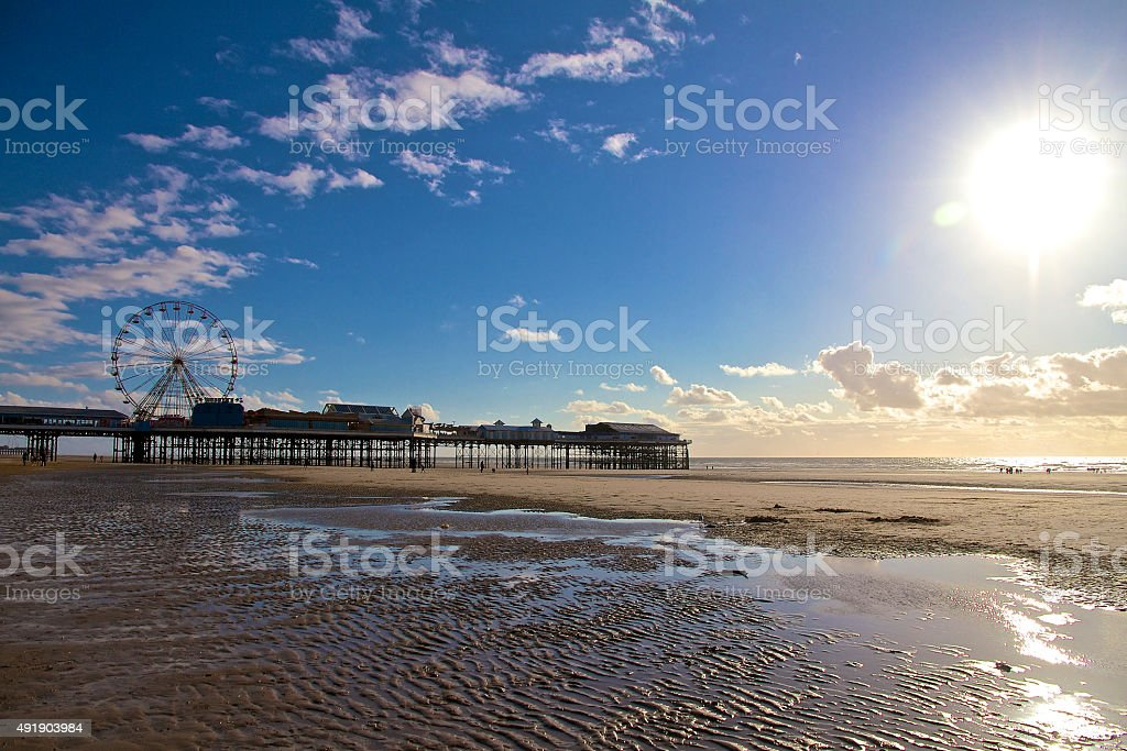 Blackpool Central Pier and Beach with Blue Sky stock photo