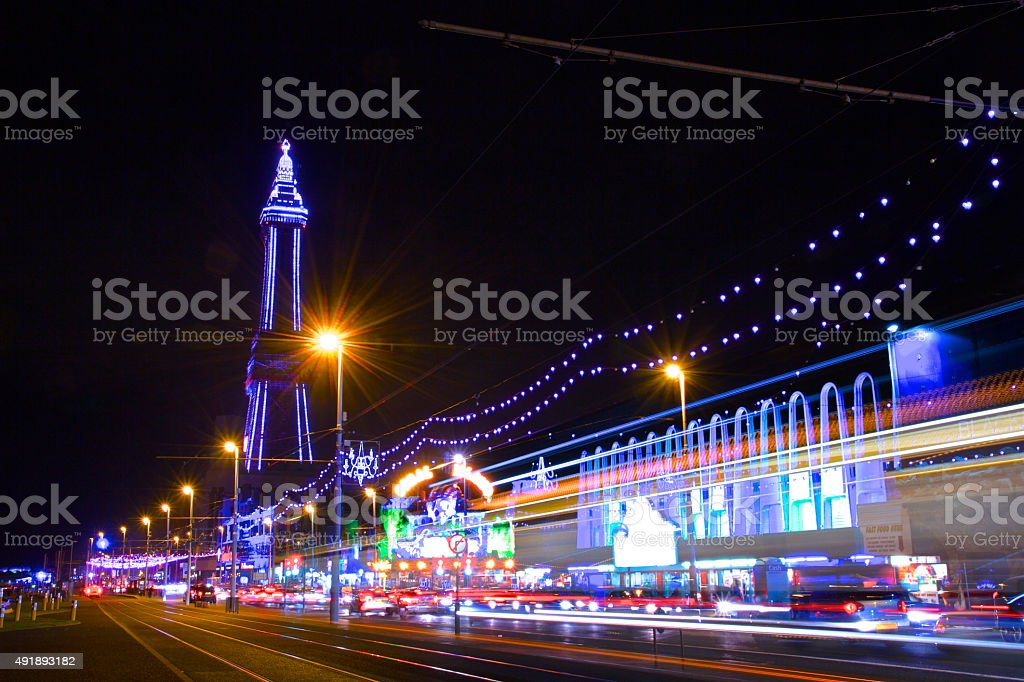 Blackpool Tower and The Golden Mile Illuminations at night stock photo