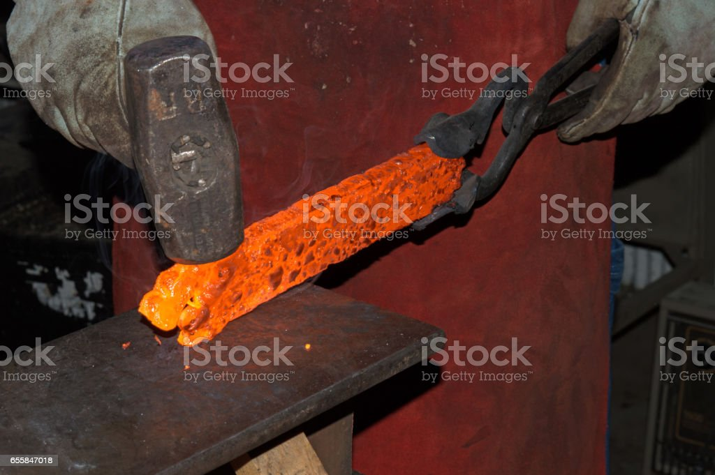 Blacksmith at Work 2 stock photo