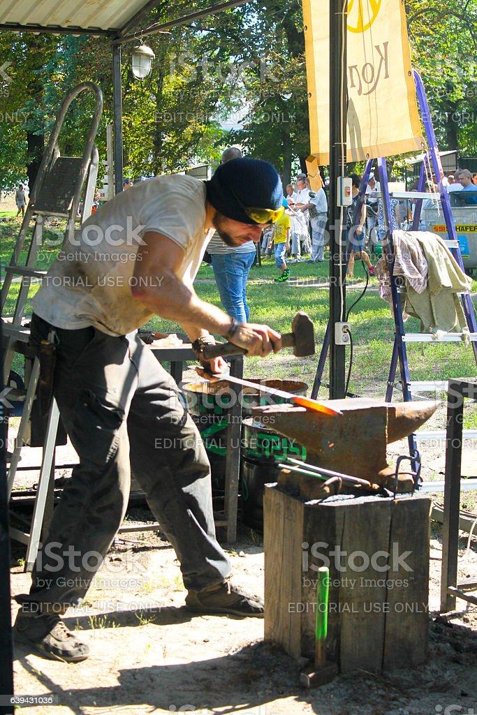 Blacksmith at work on the festival of blacksmiths stock photo