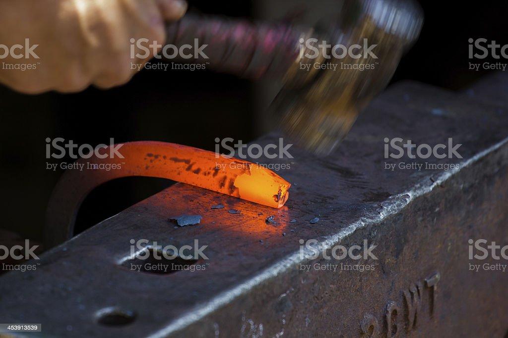 Blacksmith hammering a new horseshoe pt2 royalty-free stock photo