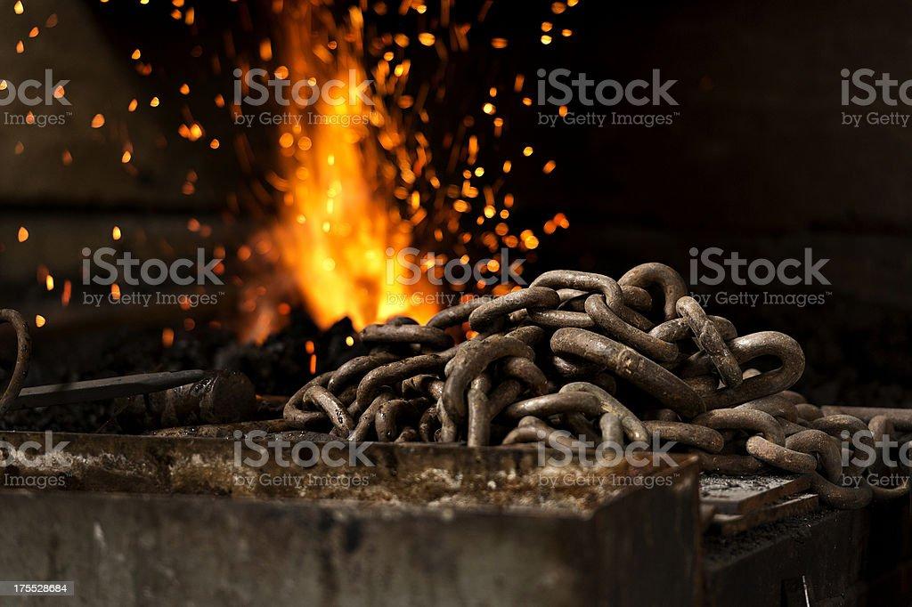 Blacksmith. Hammering steel stock photo