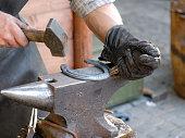 Blacksmith make horseshoe