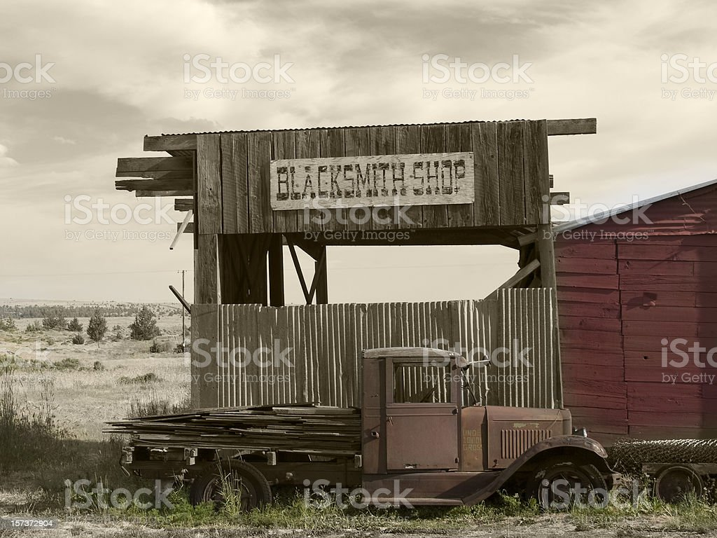 Blacksmith Shop, Old Truck, Hand-colored, Sepia-toned, Western Motif royalty-free stock photo