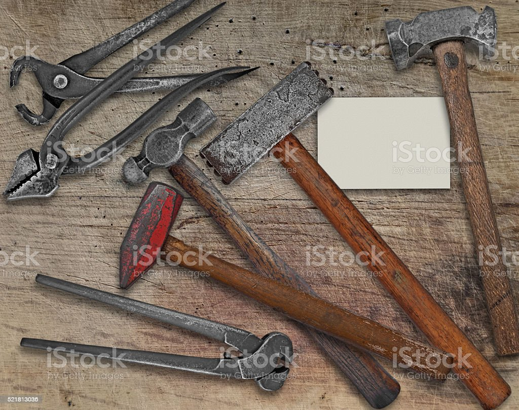 blacksmith tools and business card over bench stock photo