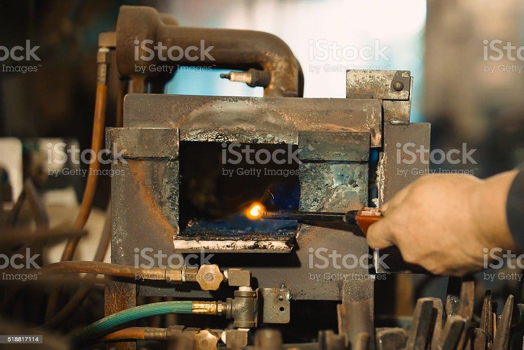 Blacksmith turn on the furnace. stock photo