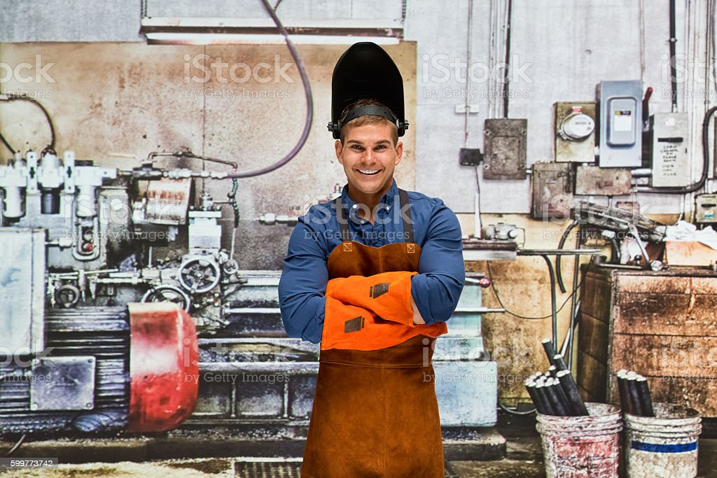 Blacksmith with arms crossed at his workshop stock photo