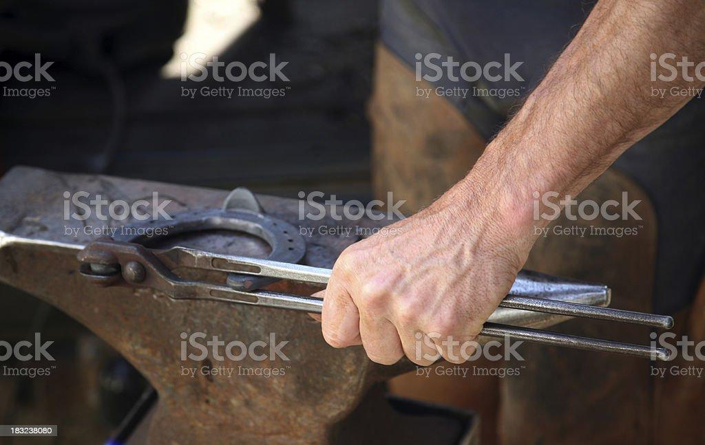 Blacksmith working 3 stock photo