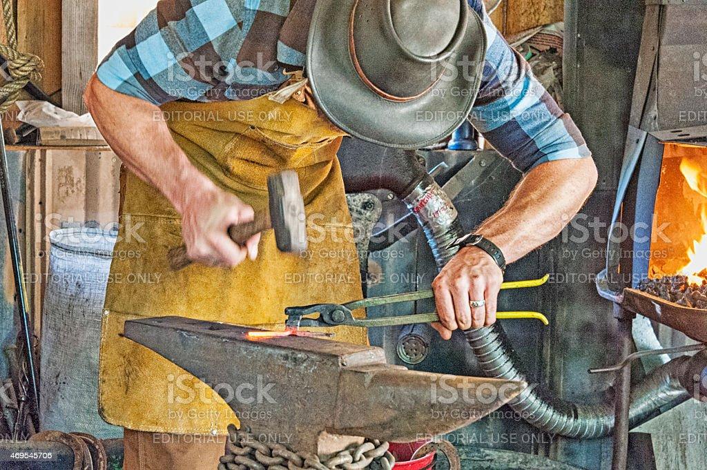 Blacksmith Working at Creating Art stock photo
