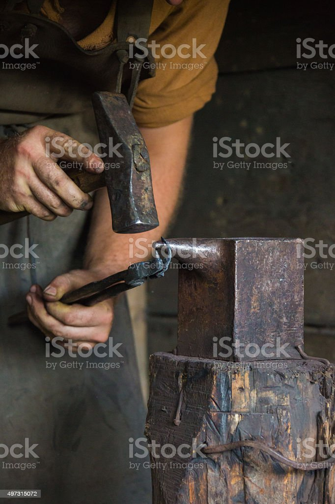 Blacksmith Working with his Tools stock photo