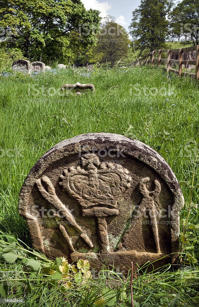 Blacksmiths symbolic old gravestone, Scottish Borders, UK stock photo