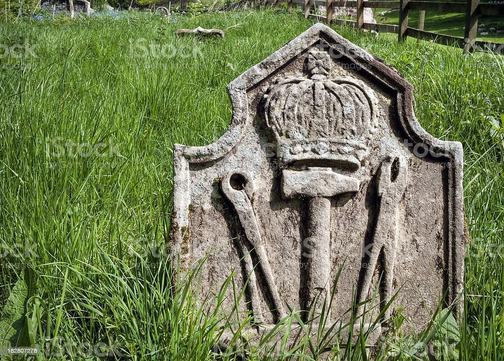 Blacksmiths symbolic old gravestone, Scottish Borders, UK stock photo