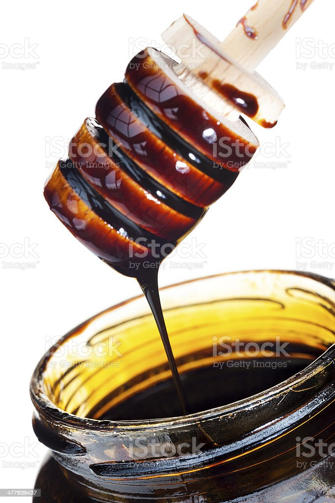 Blackstrap molasses isolated on white stock photo