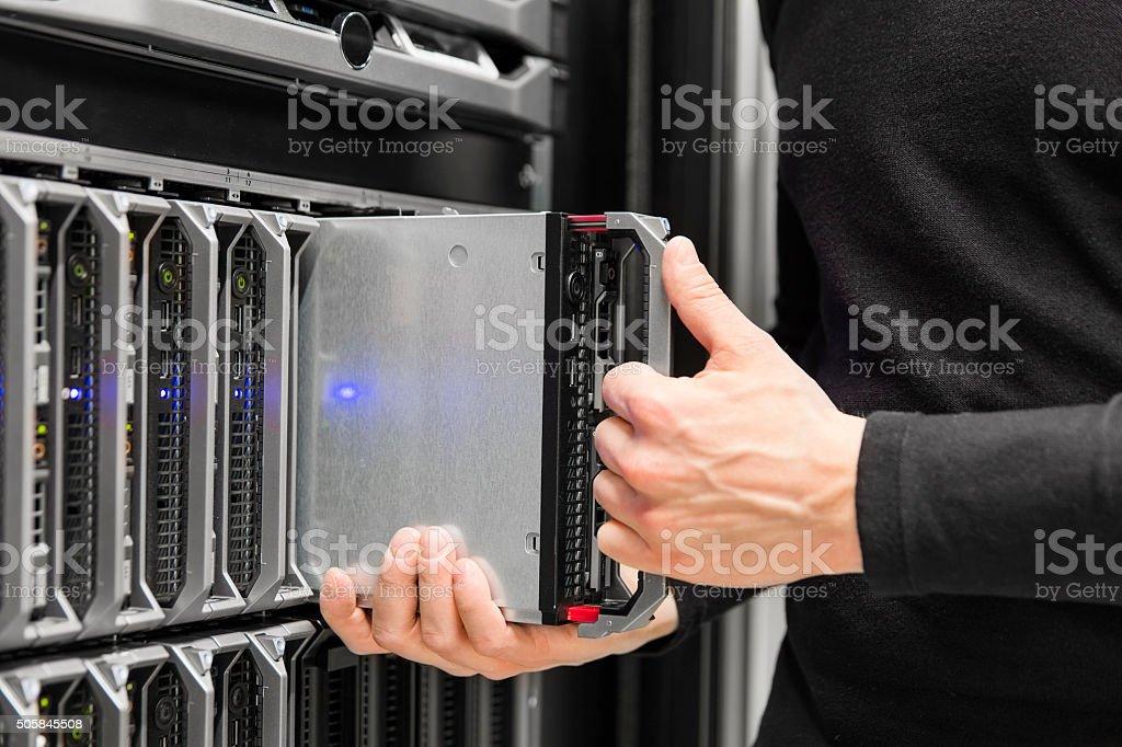 Blade server installation in large datacenter stock photo