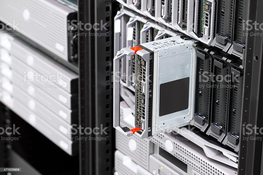 Blade server rack in large datacenter stock photo