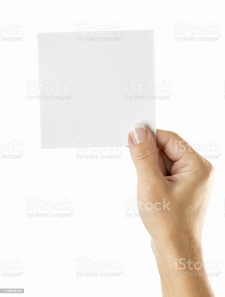 Blanc note in woman hand on white royalty-free stock photo