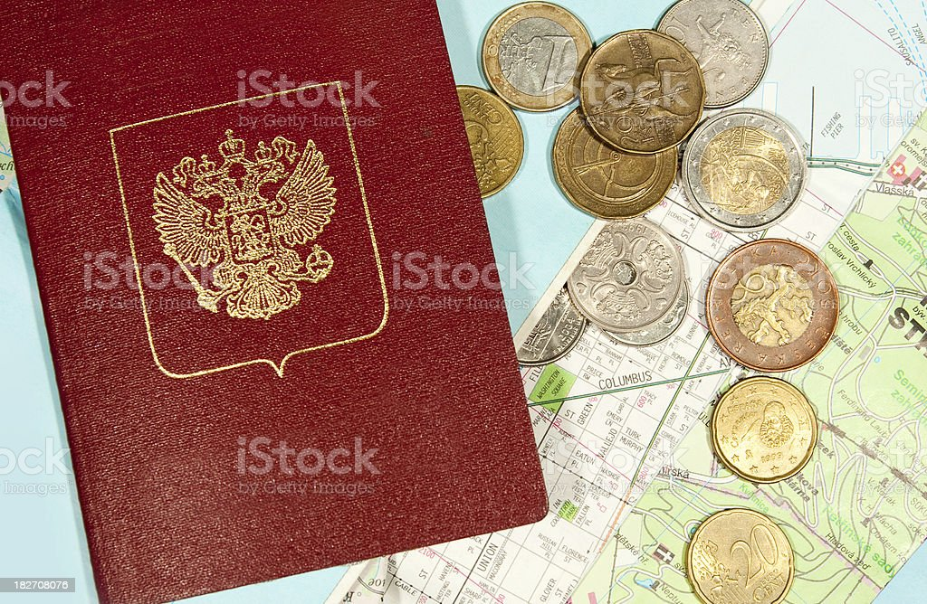 Blanc passport and many coins over different maps stock photo