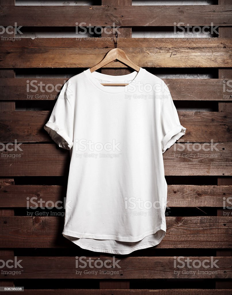 Blanc white tshirt hanging on wood background stock photo