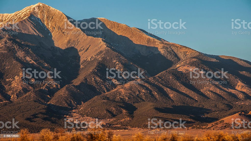 Blanca Peak at Sunset paints rugged shadows down her back stock photo