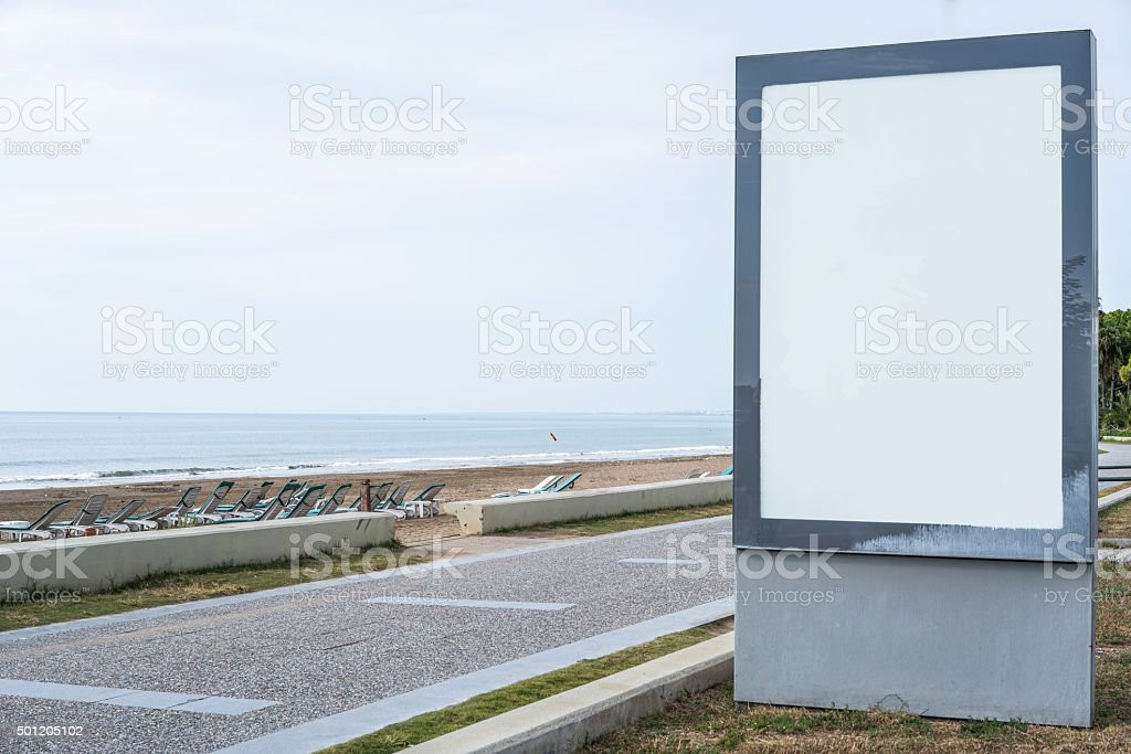 Blank ad board on the beach. stock photo