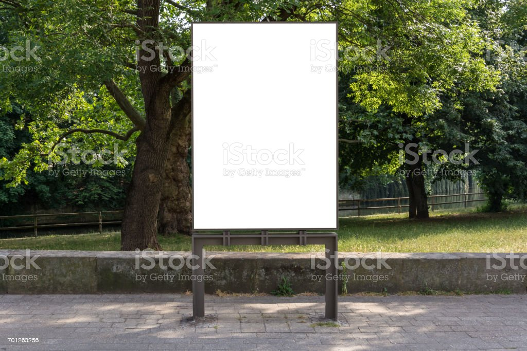A blank ad space sign isolated in front of a park