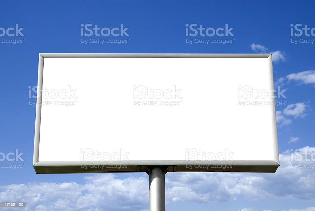 Blank advertising billboard against a blue sky stock photo