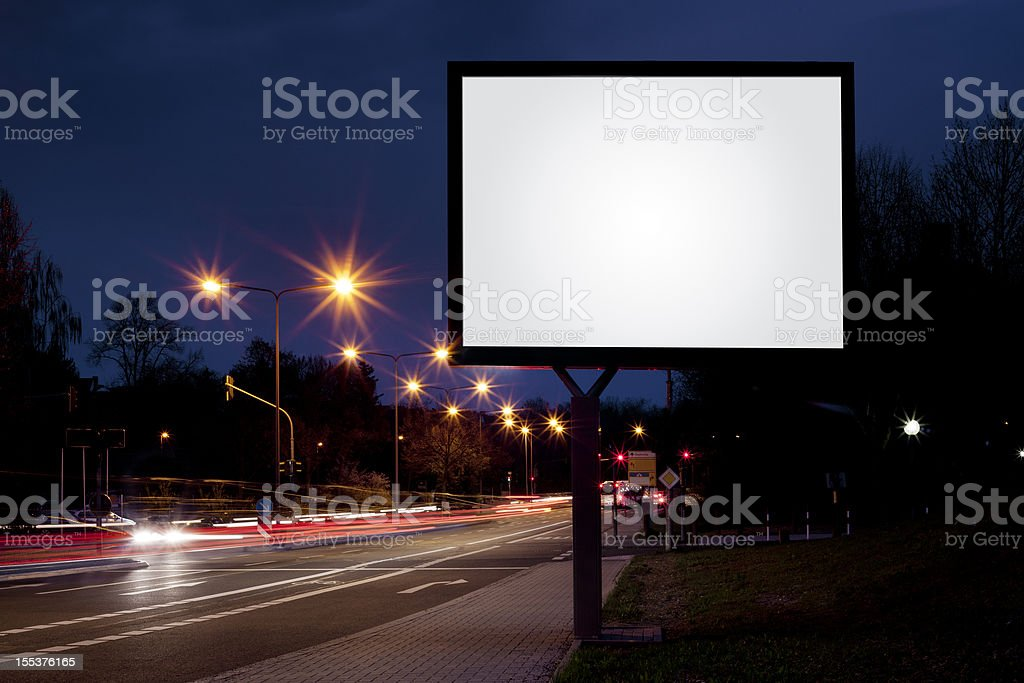 Blank advertising billboard on city street at night royalty-free stock photo