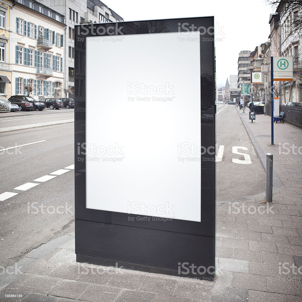 Blank advertising billboard on city street, bus stop royalty-free stock photo