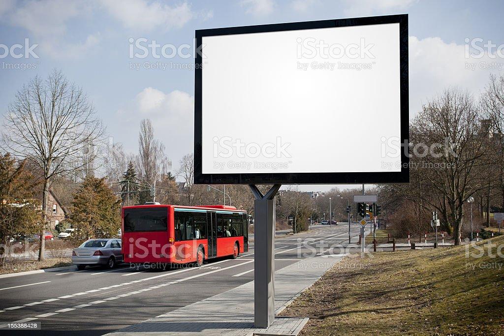 Blank advertising billboard on city street, passing cars royalty-free stock photo